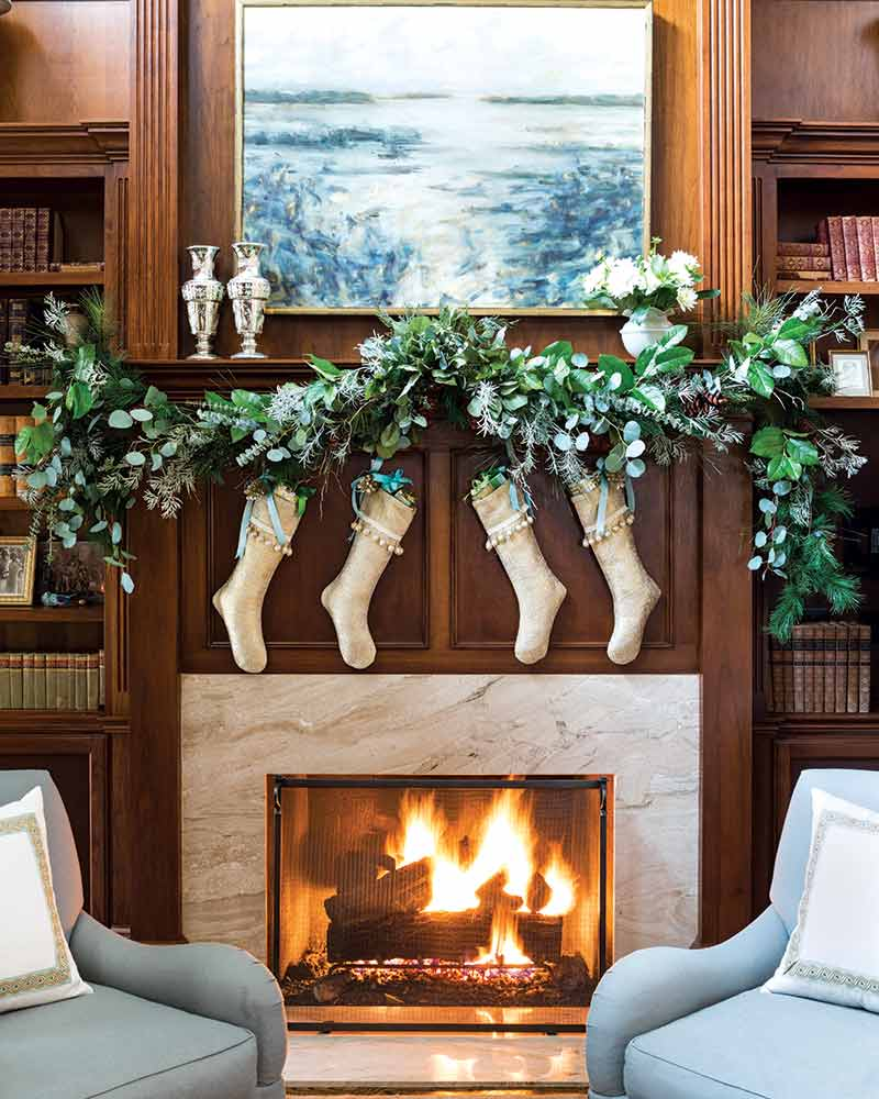 fireplace, stockings, and eucalyptus greenery