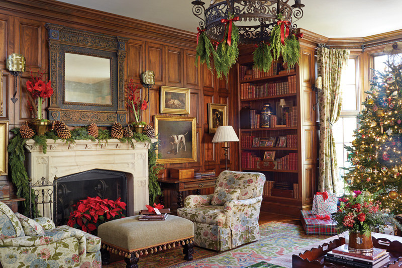 Elegant wood paneled family room decorated for Christmas