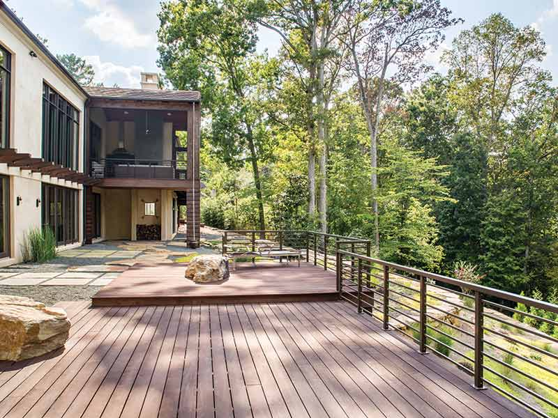 Modern back patio with a tree-top view