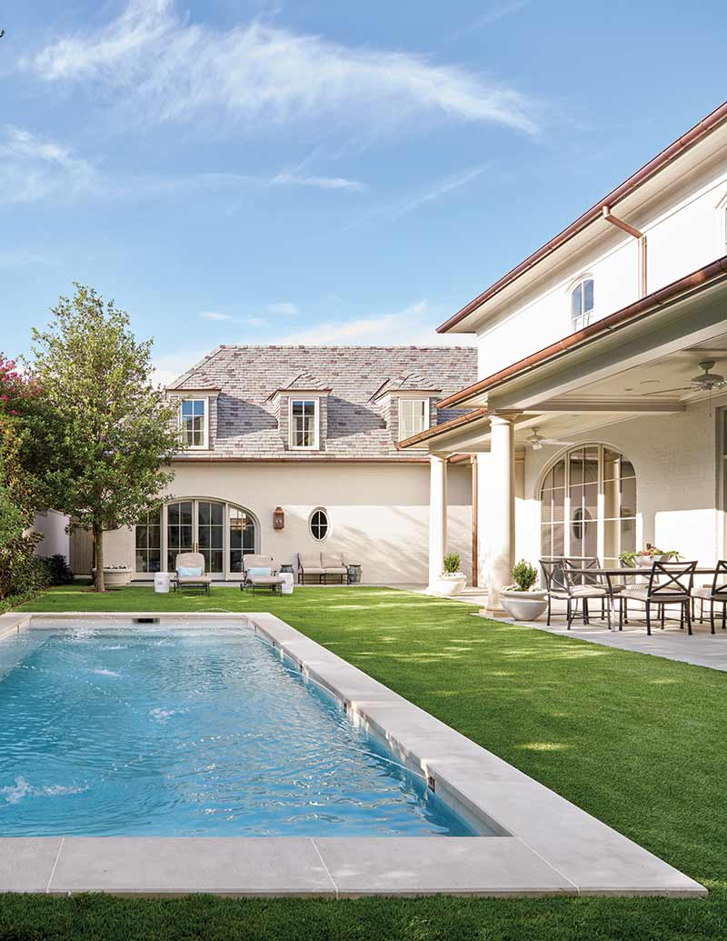Outdoor living space complete with pool.