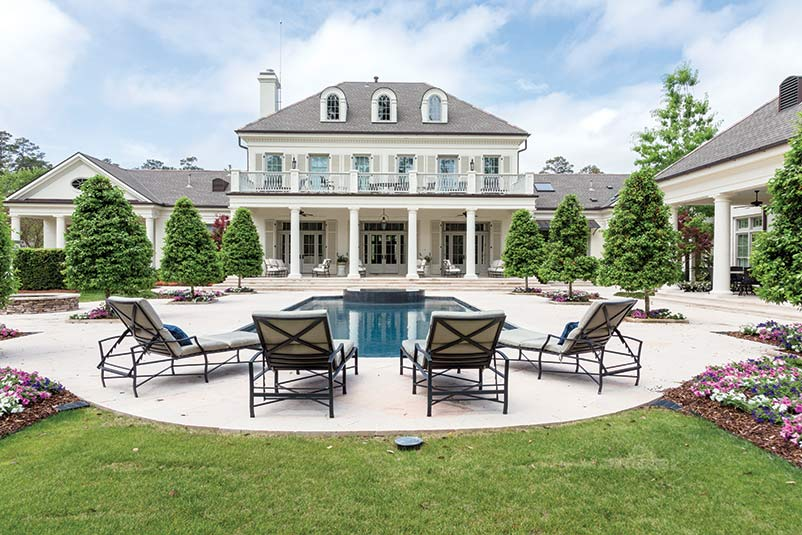 Luxurious outdoor living space with pool.