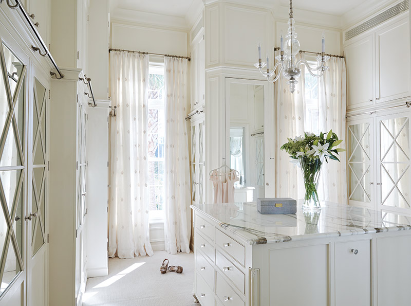 White master closet with custom cabinetry.