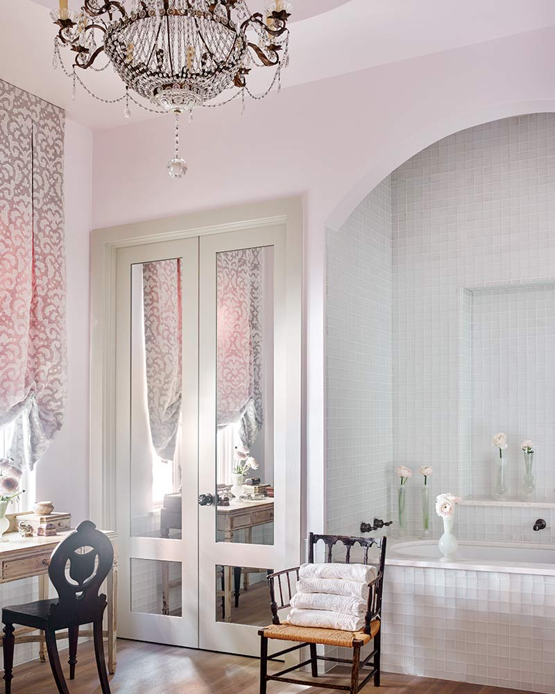 Blush pink master bathroom with tall mirrored doors