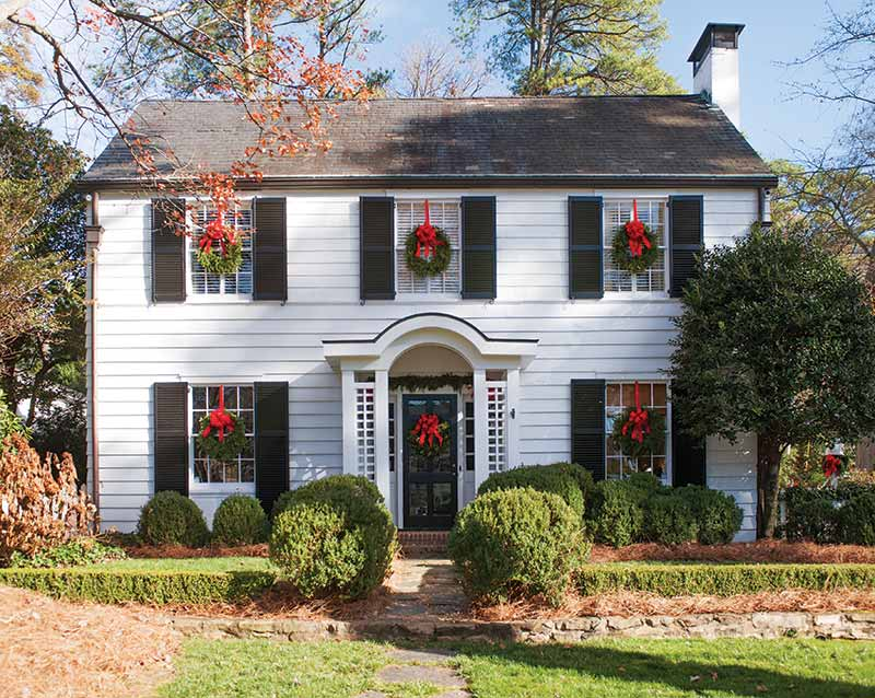 Colonial White Exterior Decorated With Christmas Wreaths