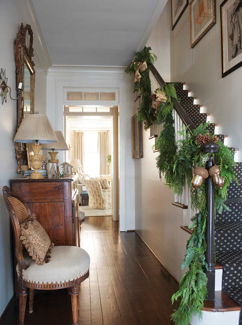 foyer with green garland