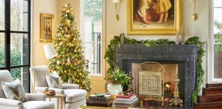 Luxury living room with Christmas tree and black mantel