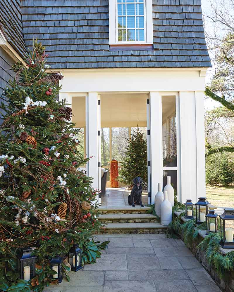 outdoor porch with festive Christmas trees