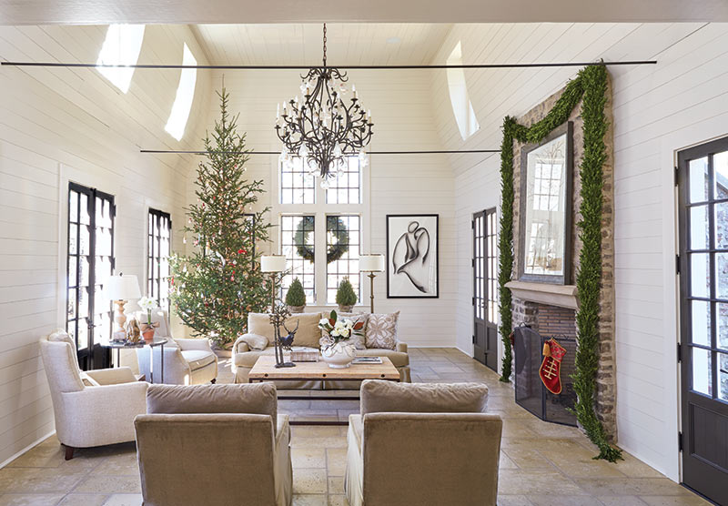 White shiplap living room with Christmas tree