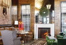 wood-paneled living room with fireplace