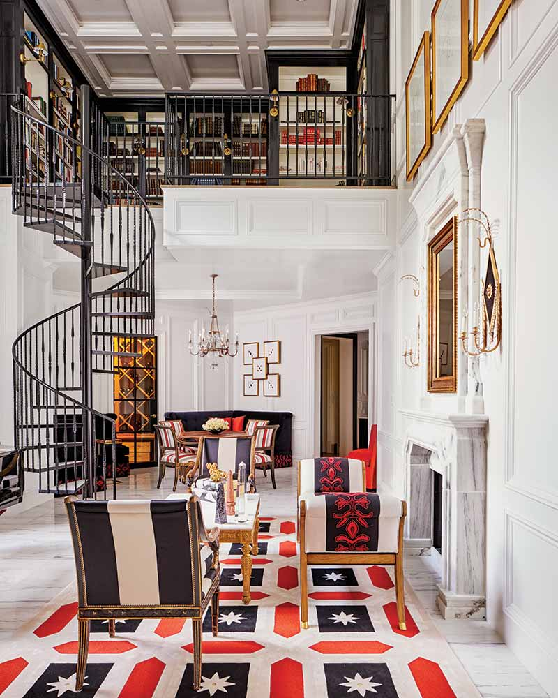 parlor with black spiral staircase leading to library