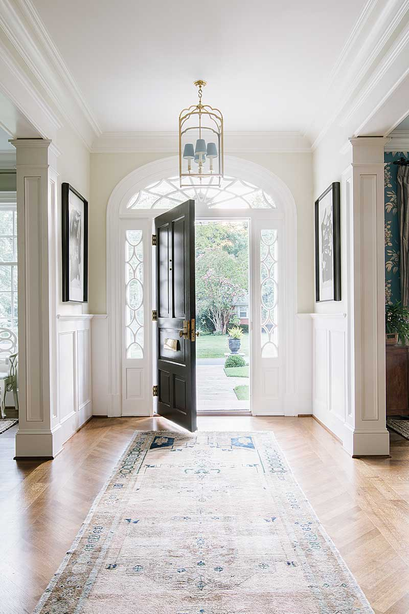 White foyer and black front door