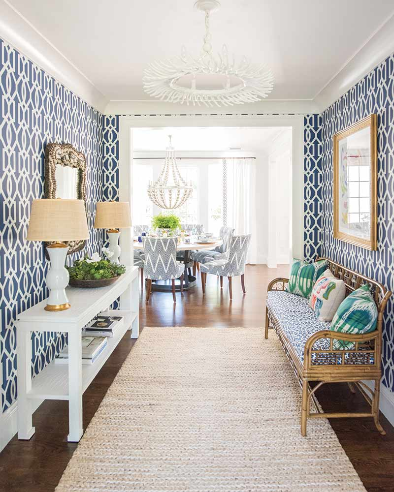 foyer with navy patterned wallpaper in coastal Georgia home